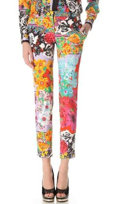 Versace turns a pair of tailored trousers into a daring, wild statement. Patterned in a riot of paisley and vintage florals, these slim pants are detailed with slant pockets at the hip and welt pockets in the back, while solid belt loops add the finishing touch. Hook-and-eye closure and zip fly.