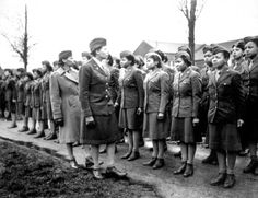 In England, Maj. Charity E. Adams and Capt. Abbie N. Campbell inspect the first contingent of African American members of the Women's Army Corps assigned to overseas service, Feb. 15, 1945.