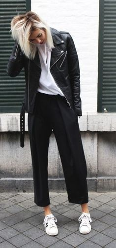 black + white street style. fall outfit. tailored trousers. belted leather jacket. sneakers.