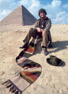 Tom Baker and his famous scarf pose for a publicity shot with a pyramid in Egypt