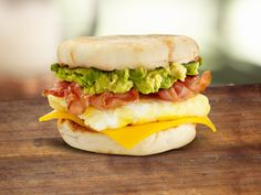 Recipe: Avocado Breakfast Sandwich Ingredients 1 English muffin, halved 1 tablespoon olive oil 2 eggs (may substitute egg whites) 1 slice cheddar cheese 1 Wholly Guacamole® Mini 2 slices bacon Breakfast Dishes, Breakfast Time, Breakfast Recipes, Avocado Breakfast, Breakfast Sandwiches, Healthy Foods To Eat, Healthy Snacks, Healthy Recipes, Wholly Guacamole