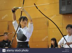 Download this stock image: Students from Urawa Municipal High School Kyudo Club demonstrate traditional Japanese archery for riders of the Tour de France on October 23, 2015 in Saitama, Japan. 2015 is the third year that the organisers of Le Tour de France have brought the race to Japan for a special one day criterium race. (Photo Kumiko Saotome/AFLO) - F4WHYY from Alamy's library of millions of high resolution stock photos, illustrations and vectors.