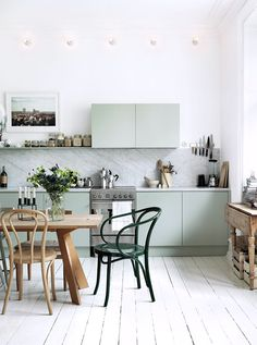 modern kitchen with marble backsplash and mint green cabinets / sfgirlbybay