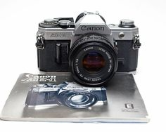 Canon AE-1 35mm Film SLR Camera with Canon f1.8 50mm Lens and Owners Manual by ValueBliss on Etsy
