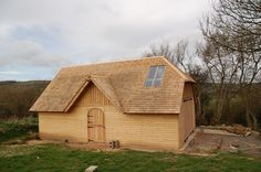 Bespoke Timber framed barn/garage. UK-grown Western Red Cedar and Douglas Fir, shingle roof. Griffinwood.co.uk