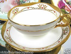 ANTIQUE MINTON TEA CUP AND SAUCER JEWELED GOLD ENCRUSTED