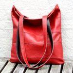 En+rød+city+bag+syet+af+sofa-læder