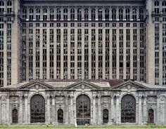 """The cover of """"Ruins of Detroit"""" by Yves Marchand and Romain Meffre shows the grand ruin of Michigan Central Station."""