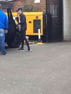 The boys arriving at the studio today in London