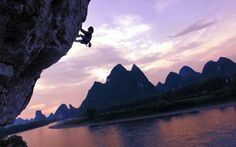 Rock climber Liu Yongbang climbs Moon Mountain in Yangshuo, Guangxi Province, China