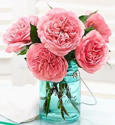 If you don't keep a vase handy for spur of the moment flowers, try keeping them in a mason jar!  The blooms will pair perfectly with the rustic look of the jar.