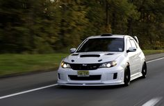 White Hatchback Subaru STi