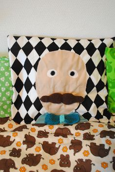 Idea for pillow or faces with detachable moustache/eyes/brows with velcro.