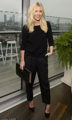 Standing tall: Mollie added some extra height to the proceedings with a classy pair of bla...