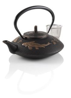 Prosperity Koi Cast Iron Teapot. I was given the marriage/new beginings one with dragon flies!! LOVE!!
