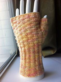 A textured mitt suitable for men or women, as written this will fit an average woman's hand or a smallish man's hand. You can easily go up to sportweight or larger needles to make a larger mitt.