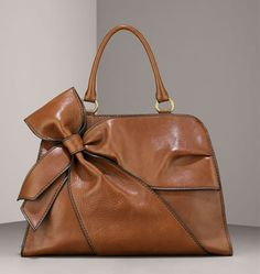Valentino Bow Bag - love the rich, camel  leather on this bag with black piping...easy to wear with black and brown and perfect for Saturday shopping!