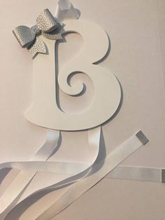 Wooden letter/initial bow holder.