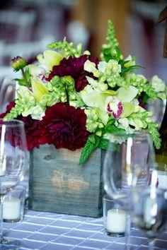 Passion Flowers www.passionflowersdesign.com; Centerpiece design, of green Hydrangeas, burgundy Dahlias, green Cymbidium Orchids, white Snapdragons, Coquelicot Vineyard