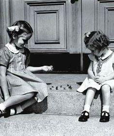 Playing Jacks on the sidewalk in dresses :)