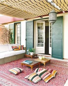 Outdoor rug, small tables, and seating - great ideas for the upstairs balcony
