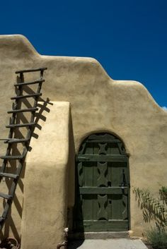 Adobe Home - Heavy door has the look of being hand crafted.