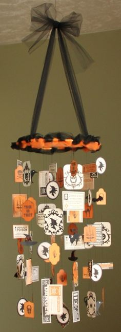 halloween mobile -- also inspiration for a way to use vintage holiday postcards and other ephemera