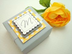 Bright and colorful wedding favor boxes in yellow and gray by simpletastes. #ThePerfectPalette