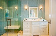 Malibu guest bath.  Like the glass vertical tile and floating seat in shower