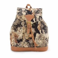 The tapestry handbags have a reinforced base with silver studs to protect the…