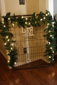 I love this gate with garland and lights I found at Coastal Charm blog.
