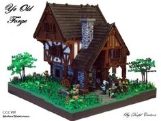 Ye Old Forge :: Dumnonia - Century 'The Age Of Castle'. My entry for the CCCVIII Medieval Maintenance catogory. Lego Dragon, Lego Knights, Lego Display, Old Forge, Lego Spaceship, Medieval Houses, Lego Castle, Lego Design, Lego Worlds
