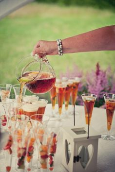 Pimms with fruit already in glass. Emily and Matthew's 'Vintage Meets Rock n Roll' Welly Wearing Wedding by Kari Bellamy - Boho Weddings™