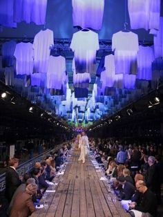 Raw wooden planks formed a dining table and doubled as a runway during fashion…
