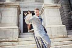 Ha! Love this shot of the groom sliding down the City Hall steps. :)