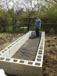"""building a raised bed garden with cinder blocks - & another pinner said to fill the """"holes"""" with flowers/herbs! by lydia"""