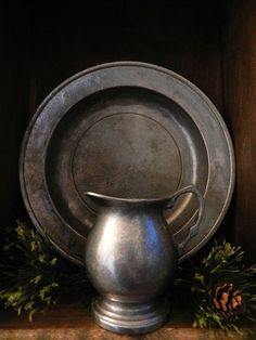 This is a plate and jug made out of pewter, the material we are planning to make a pendant out of (which will then go on the end of a necklace). This looks like a very nice metal that we look to draw inspiration from. Country Primitive, Primitive Decor, Country Sampler, Primitive Antiques, Primitive Christmas, Country Christmas, Rustic Decor, Verona, Vases