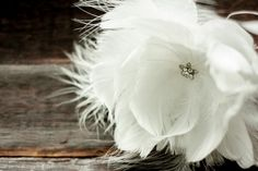 White feather hair pin by designer @anemone on sale for $30