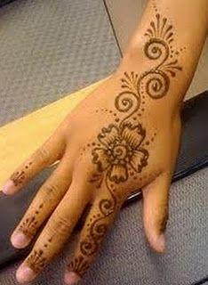 Simple henna flower design - hand