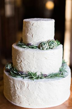 This white wedding cake adorned with succulents and lavender would complement a woodsy winter wedding. CreditsPhotographers: Flora + FaunaView PostOh-So-Chic