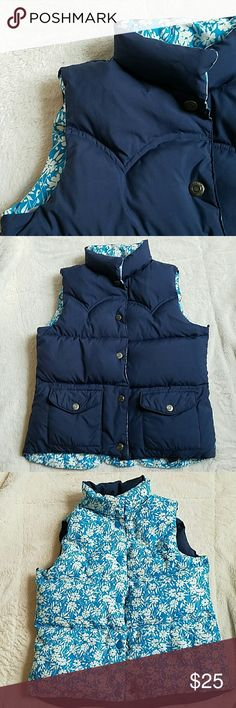 REVERSIBLE Puffer Vest 2-in-1! Reversible puffer vest from American Eagle. Navy vest on one side and when reversed a pretty bright blue and white floral pattern. EUC. American Eagle Outfitters Jackets & Coats Vests