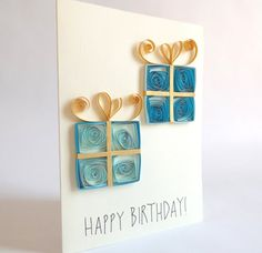 Paper Quilled Birthday Card, Birthday Present Card, Happy Birthday Card  This listing is for one birthday card, decorated with two blue paper quilled presents.  Measurements: 15 x 10.5 cm (5.9 x 4.1) Fitting envelope included. The inside of the card is left blank for you to write your special message on.  Because of the unique qualities of quilling, no card will be exactly alike. This makes each card one of a kind, and you will receive the card that is shown in the photos. Please note that…