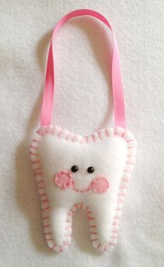 Tooth Fairy Pillows Your choice of color WITH a custom hangging ribbon. $9.00, via Etsy.