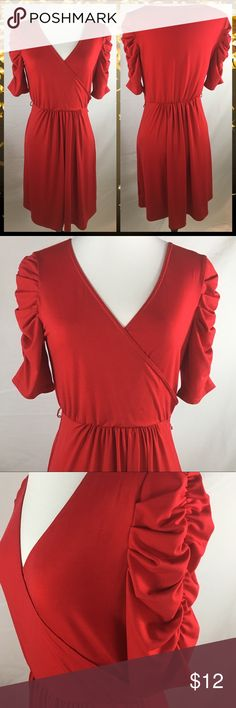 "NY Collection Red Fitted Dress SZ S NY Collection Red Fitted Dress SZ S.  Stunning Red Fitted V Neck, elastic waist and unique puff sleeves. Can be worn with or without belt. Excellent condition - no flaws. 95% Polyester and 5% Spandex. Measurements: C 15"" W 10"" L 35"". NY Collection Dresses Midi"