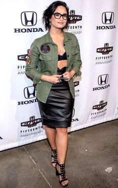 DEMI LOVATO in an open olive Zadig & Voltaire button-down showing off her bra top and high-waist skirt, accessorized with studded sandals at the Honda Civic Tour Artists Announcement in N.Y.C.