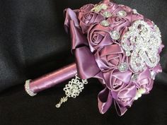 Beautiful mauve colored silk bouquet. Love this idea for bridesmaids or renewal of vows ceremony.