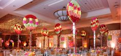 The centerpieces designed for the event were peace signs covered in color blocks of carnations.