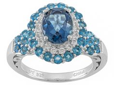 1.8ct Oval London Blue Topaz With .88ctw Round Blue Neon Apatite And .