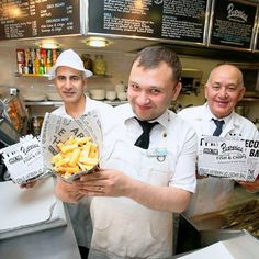 Poppies Fish & Chips Restaurant staff members (L-R) Mehmet Emin As, Hurshed Aburahimov and Salih Sadik show up one of their fish & chips meals, as the restaurant has been shortlisted  by Seafish for the country's  best independent fish and chips restaurant.