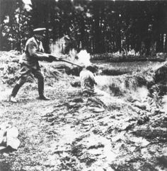A photograph of an execution of an Eastern European by Hitler's mobile killing squad known as the Einsatzgruppen who were responsible for the deaths of 1.3 million Jews and Slavs.